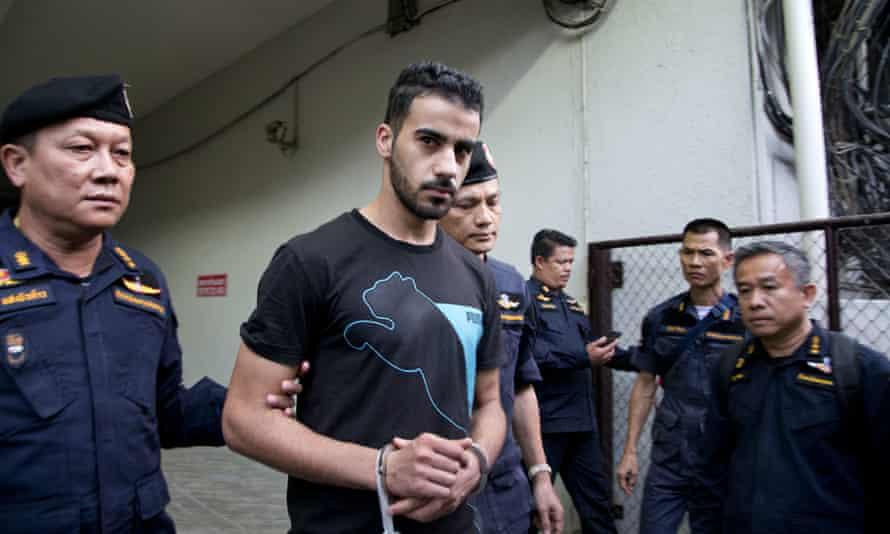 Thai prison guards lead football player Hakeem Al-Araibi, from a court house in Bangkok.