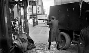 A soldier opens fire in Dublin in June 1922, during the Irish civil war.