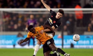 Harry Maguire (top) picked up his hip injury in the 0-0 FA Cup draw at Wolves.