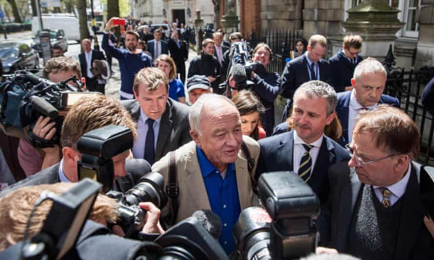 Ken Livingstone is followed by reporters as he leaves BBC studios.