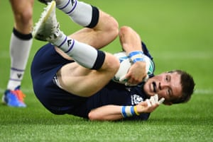 Scotland's George Horne scores their fourth try .