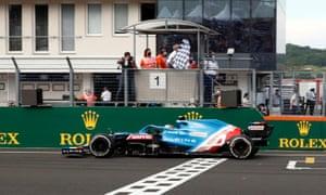 Alpine's Esteban Ocon crosses the line to win the race.