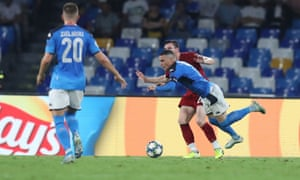 Andrew Robertson of Liverpool fouls Jose Callejon of Napoli for a penalty.