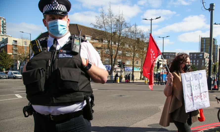 A police officer and demonstrator during a protest against the police, crime, sentencing and courts bill that is currently before parliament, in London on 2 April.