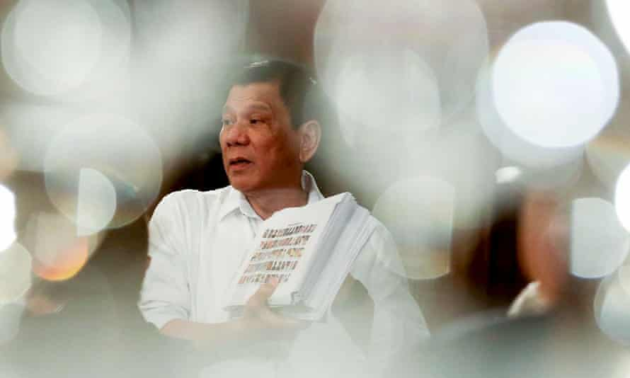 Duterte with a list of officials he says are involved in illegal drugs