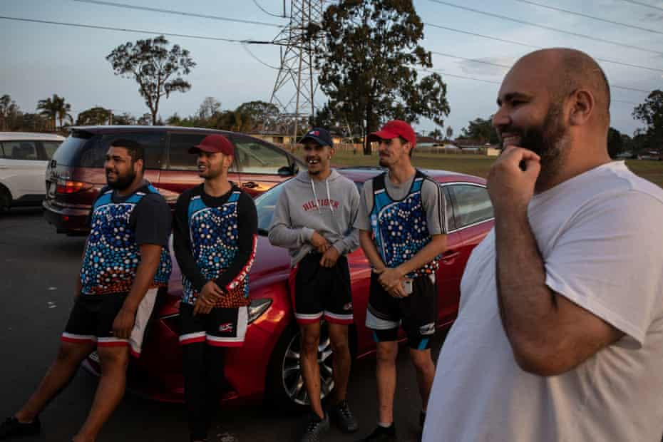 Victory pose: Gamilaraay man Daniel Daylight (far right) who helped create the Youth Koori Court and Dhungatti man Isaiah (second from left) with members of their touch football team.