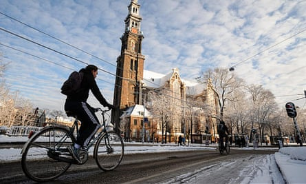 Cyclists in Amsterdam: 'The Netherlands and Denmark have spent decades deliberately re-shaping their road environments away from the car culture of the 1960s and 70s towards mass cycling.'