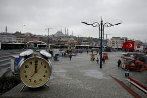 A clock showing the time at noon in the Eminonu district of in Istanbul,Turkey