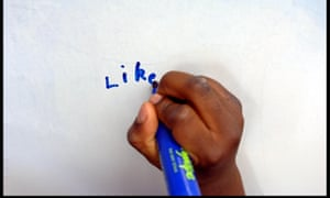 A child practises writing.