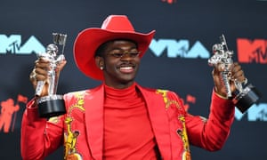 Lil Nas X poses with the Song of the Year Award