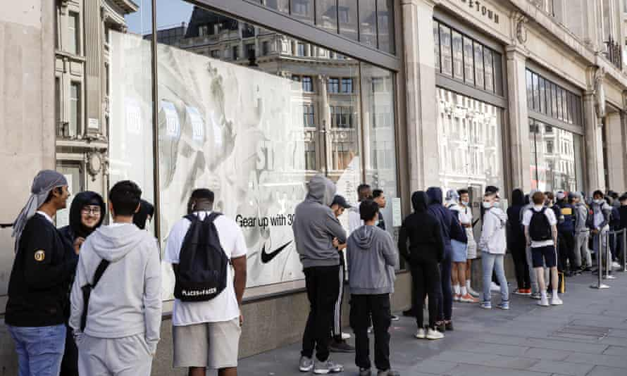 People queue to enter the Niketown shop in London, Monday