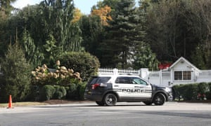 A police car in front of the home of Hillary Clinton in the New York suburb of Chappaqua.