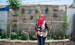 Avine Ismael in her garden at Domiz refugee camp.