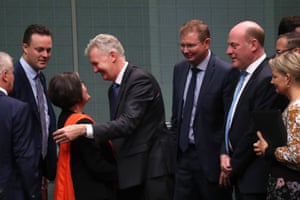 The independent member for Indi Cathy McGowan is congratulated by the manager of opposition business Tony Burke and others