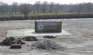 Drilling equipment lies next to a shipping container housing the exploratory well-head at Horse Hill, near Gatwick airport.
