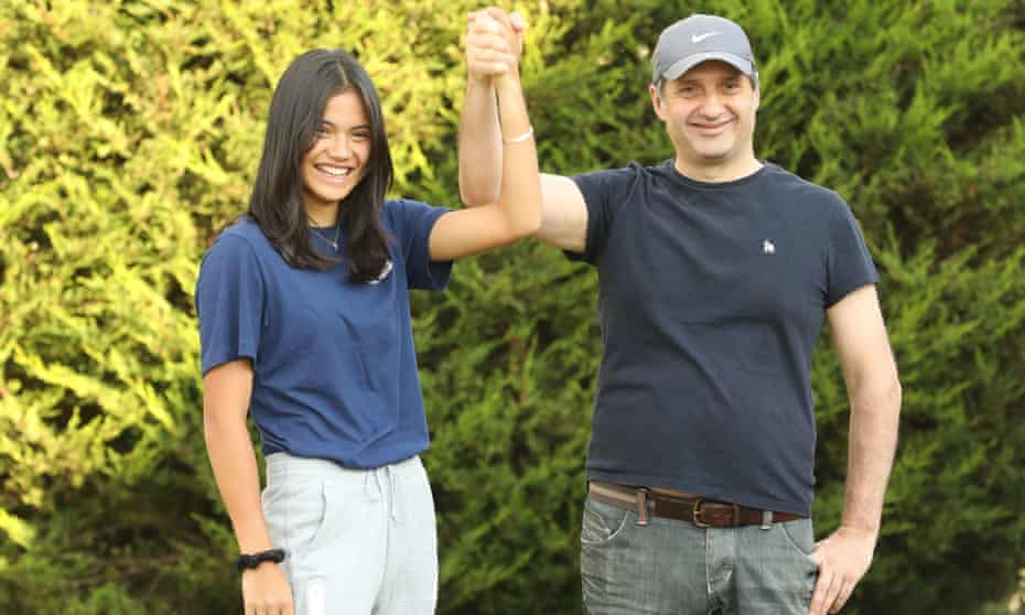 Emma Raducanu reunites with her father Ian on her return home to the UK.
