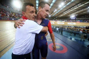 Coach Heiko Salzwedel is the first to grab an exhausted Wiggins