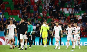 Hungary's Willi Orban, Adam Szalai, Gergo Lovrencsics, Laszlo Kleinheisler and Kevin Varga leave the pitch with a look that's a mixture of disbelief and dejection.