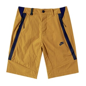 golden beige shorts with dark blue strips on the side Nike