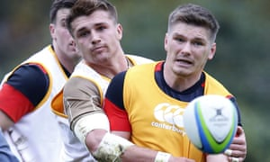 Owen Farrell, right, and Henry Slade in the thick of the action at England training this week.