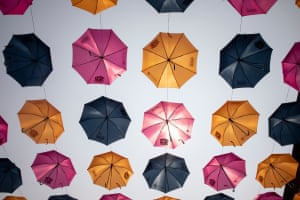 Decorative umbrellas hang above 3rd Street in downtown Wausau.