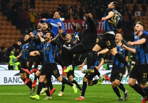 Internazionale players celebrate at the end of their derby win.