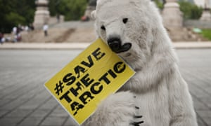 A Greenpeace activist fancy dressed as a polar bear participates in a protest against oil