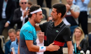 Novak Djokovic embraces Marco Cecchinato after his defeat to the Italian.