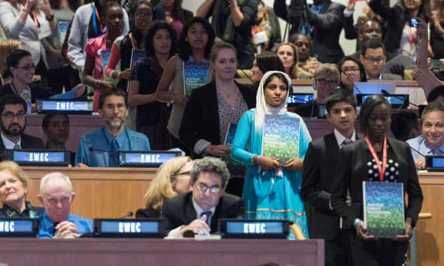 Young people deliver print copies of the new global strategy for women's, children's, adolescents' health at the UN in New York on 26 September