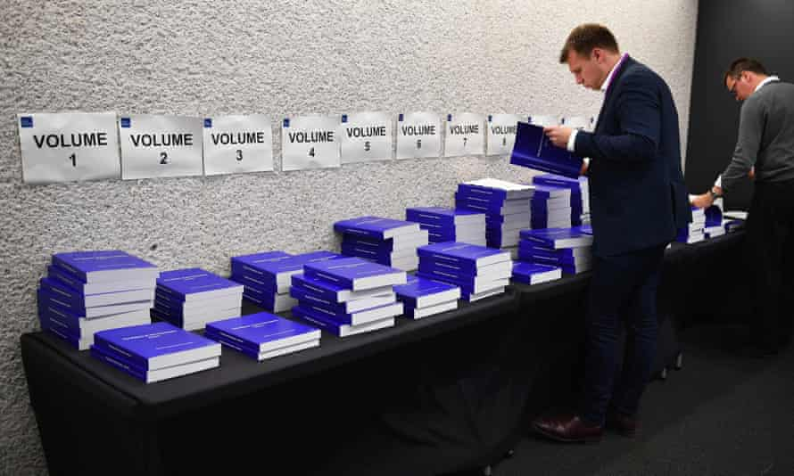 Members of the media inspect the Chilcot report