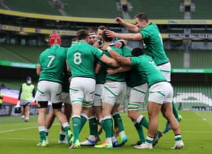 Ireland players celebrate after Keith Earls scores their first try of the match.