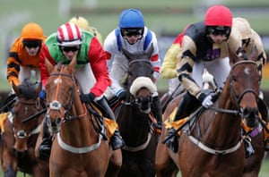 Harry Cobden settles in Clan Des Obeaux behind the early leaders in the Gold Cup, the big race of the day.