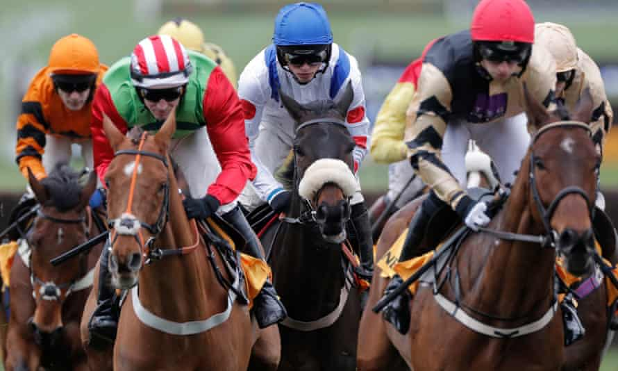 Clan Des Obeaux (centre) on his way to victory at Aintree.
