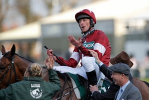 The moment that Davy Russell hears the result of the photo-finish that he won the race on Tiger Roll