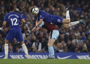Chelsea's David Luiz climbs all over Burnley's Ashley Barnes.