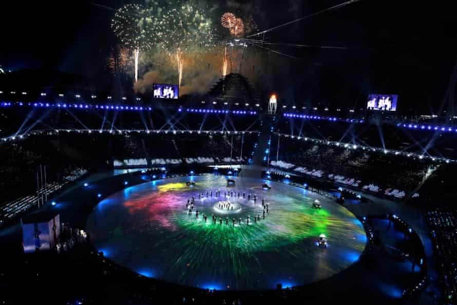 EXO performing in Pyeongchang, with fireworks going off in the background