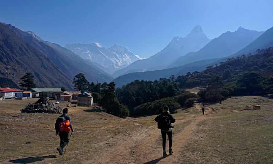 Trekkers walking through the Mount Everest range in Tengboche in April 2021