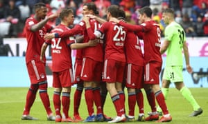 Bayern's players celebrate after their third goal against Hannover