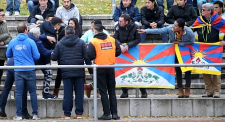 A Chinese spectator attempts to tear away a Tibetan flag which was raised at the game betweens TSV Schott Mainz and China's U20 team.