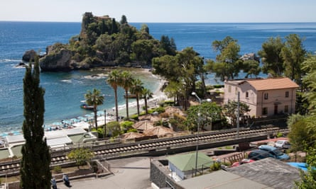 Taormina railway line with Isola Bella in the background, Sicily.