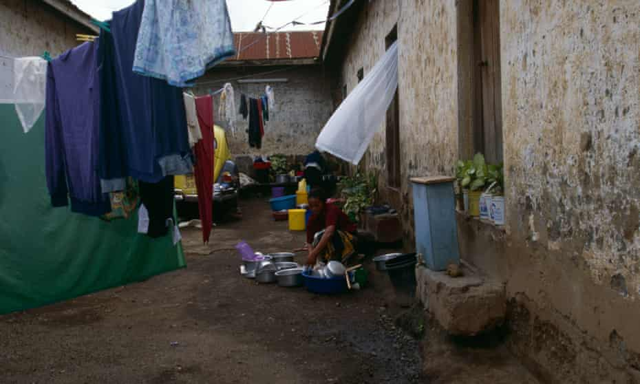 A woman performs chores at a home in Tanzania