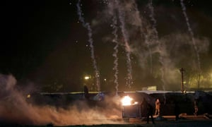Trailers from tear gas cannisters fired by French CRS riot police are seen on the eve of the dismantlement of the camp.