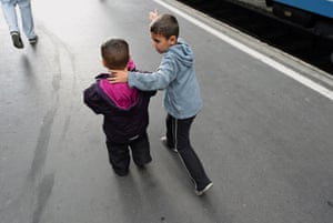 Budapest, Hungary Children of a refugee family walk along a platform of the Eastern railway station as their parents are look for a train for bound for the Austrian border.