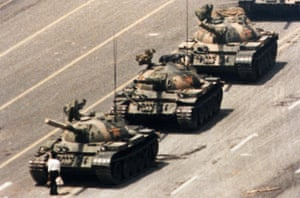 A Chinese man stands in front of a column of tanks in Beijing on the morning of June 5, 1989