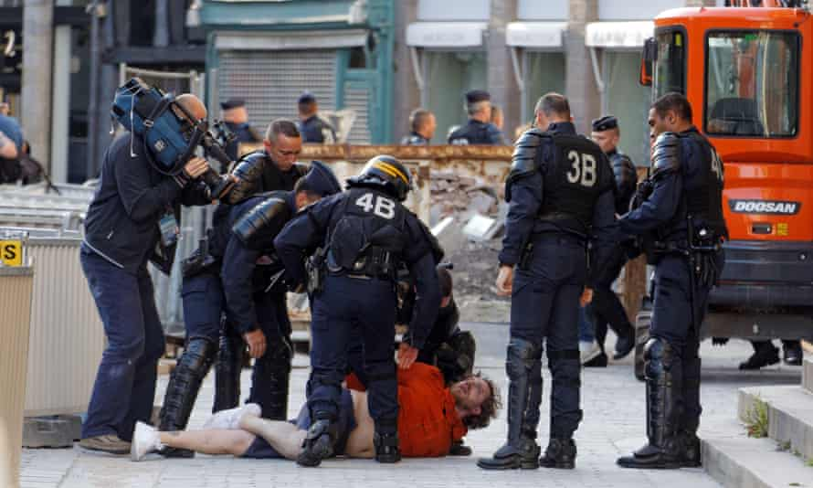 Police arrest a football fan in the city centre of Lille, France.