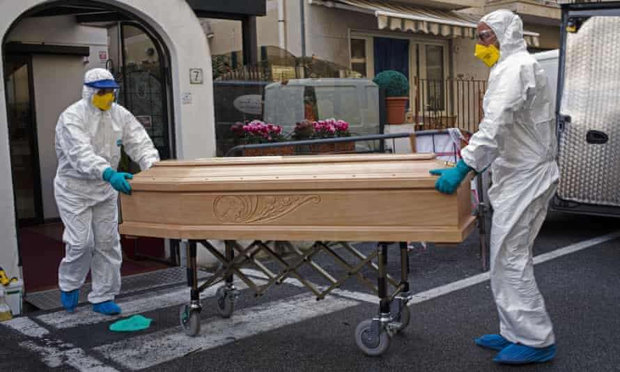 Medical staff with the coffin containing the body of Assunta Pastore