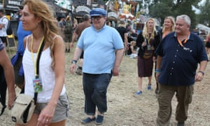 Labour's deputy leader Tom Watson soaks up the Glastonbury atmosphere.
