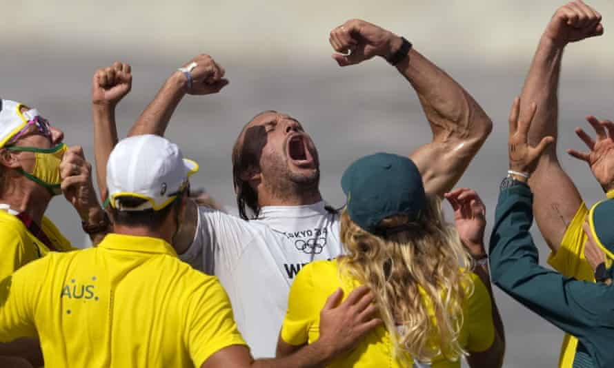 Australia's Owen Wright celebrates winning the bronze medal heat in the men's surfing competition.