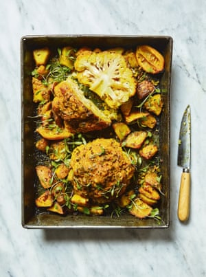 Serve this aloo gobi the middle of the table, with little bowls of yoghurt, almonds and coriander for sprinkling on top.