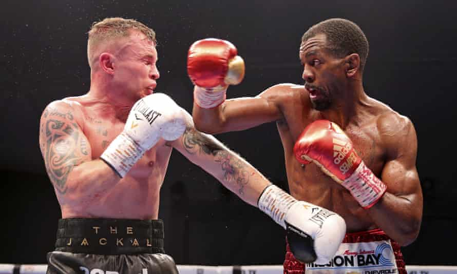 Carl Frampton is caught by a right from Jamel Herring during their WBO super-featherweight world title fight in Dubai